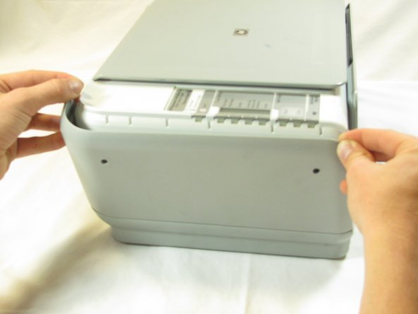 Firmly pull the the back of the side panel until it separates from the body of the printer.