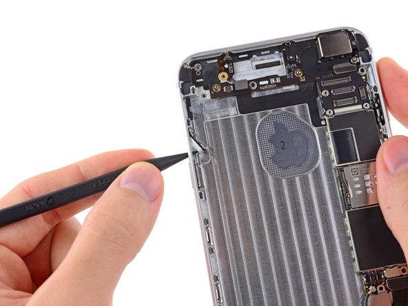 Use the tip of a spudger to push the audio control and rocker switch buttons out of their recess on the rear case.