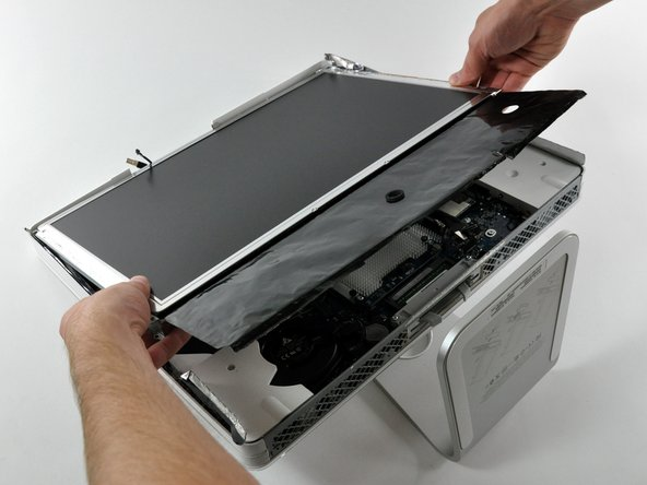 Lift the display from its lower edge and pull it toward yourself to peel off the EMI shield attached to its top edge.