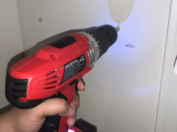Pull out the loose screws and plugs to expose the holes in the wall.