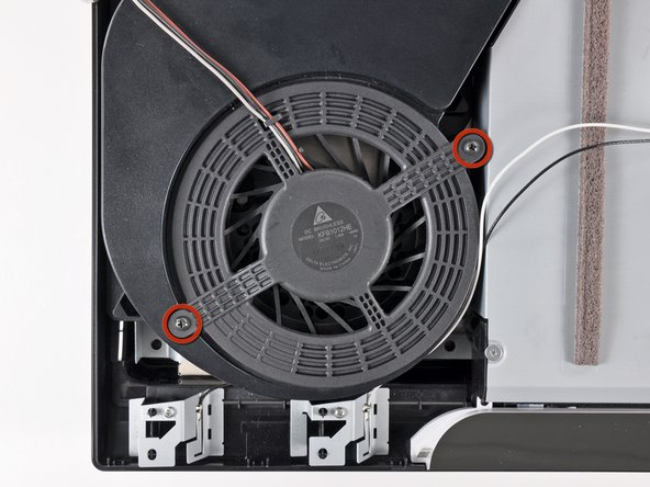 Remove the two 9.5 mm Phillips screws securing the fan to the heat sink.