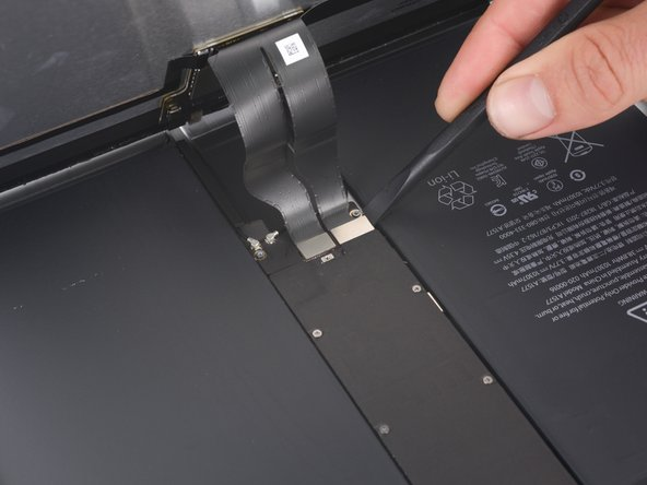 Use the flat end of a spudger to disconnect the two display data and digitizer cables from their respective sockets on the motherboard.