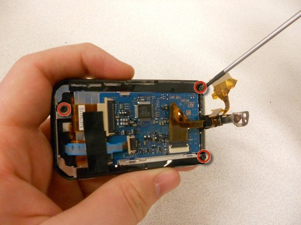 Remove (3) 4.5mm screws from back-side of the LCD.