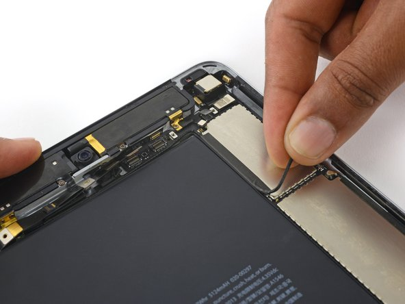 Peel the upper antenna interconnect cable up off the logic board.