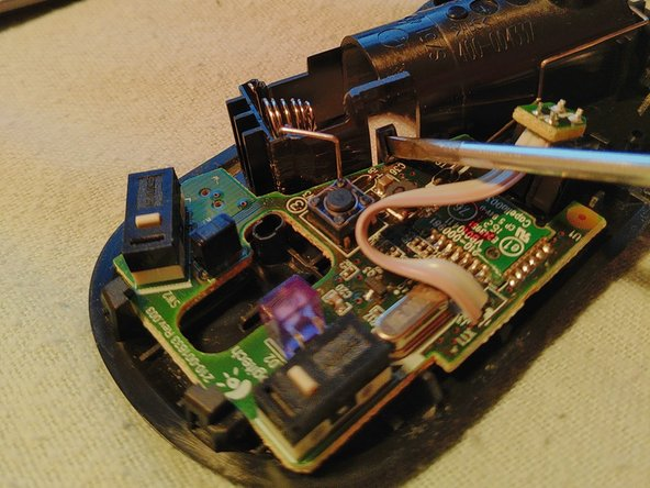 Press the clip to release the circuitboard.