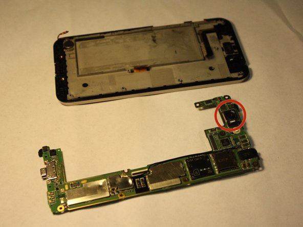 Turn over the logic board to locate the front camera.