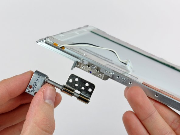 Remove the right clutch hinge from the front display bezel.