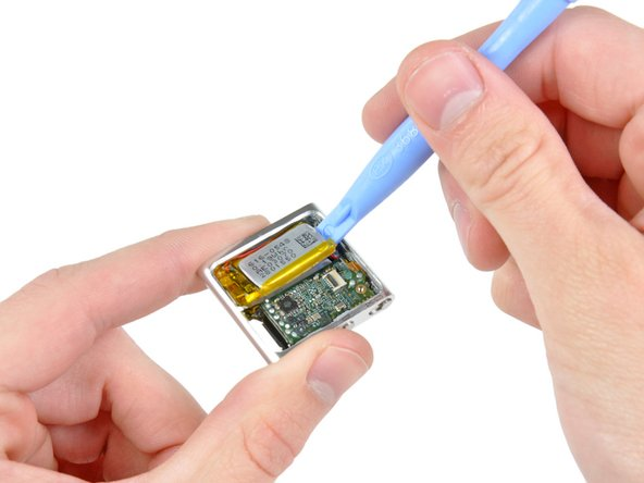 Use an iPod opening tool to gently pry the battery off the adhesive securing it to the front case.
