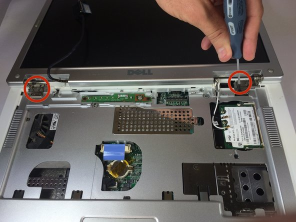 Remove four 4mm #00 Philips screws from the screen hinges.