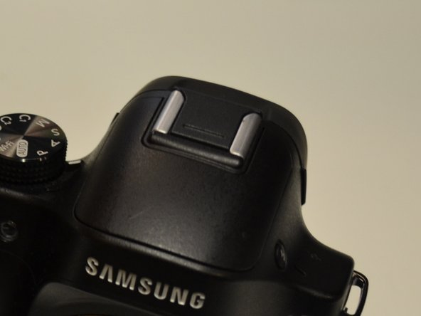Once the screws have been removed, push the flash head back down.