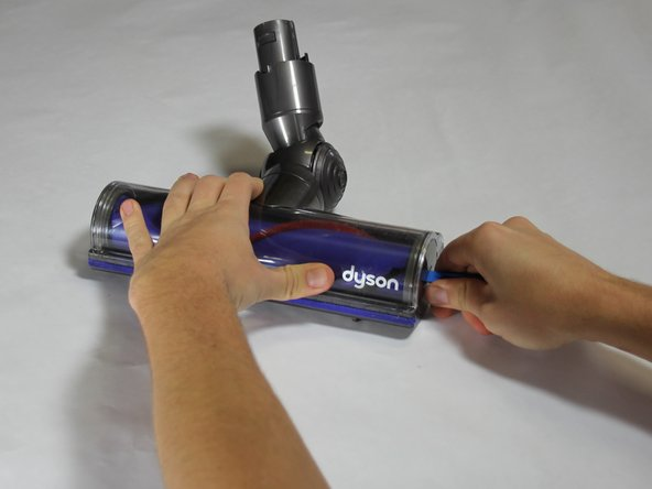 Turn the end cap counterclockwise using the iFixit Opening Tool.
