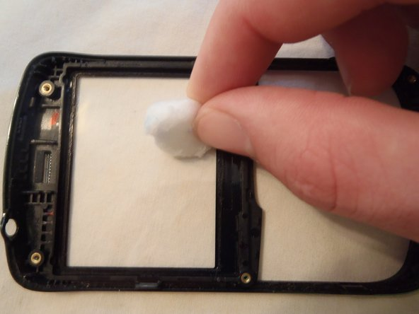 My phone took a trip through the washing machine.  Due to this, there was soap underneath the plastic and LCD screen.  Take a cotton ball or swab (your pick, but only for this step!) and clean down the plastic and keypad.