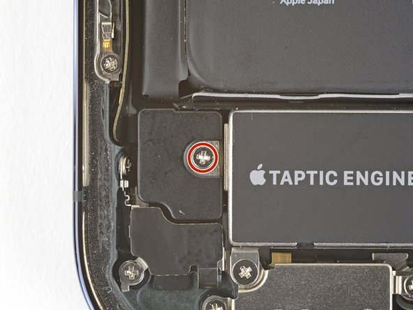 Use a Phillips driver to remove the 1.4 mm screw securing the Taptic Engine plastic cover.