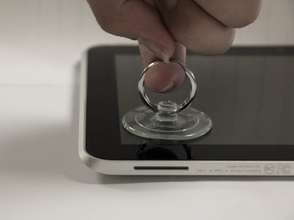 Use a suction cup to pull the display assembly up.