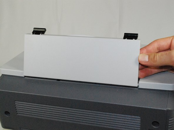 Remove the top hinged panel by taking out the pins at the bottom of this panel.