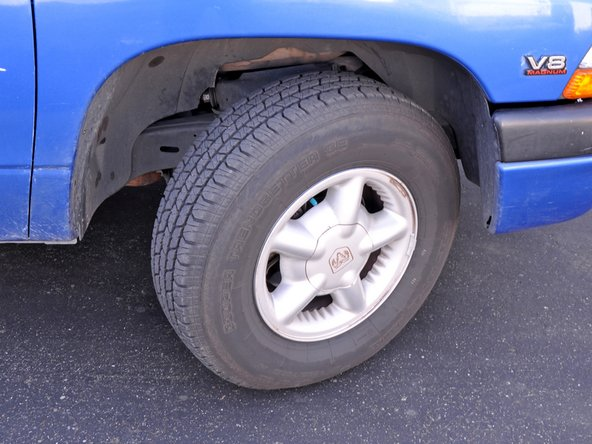Park the truck on a flat surface with the wheels turned so you can access the shocks easier.