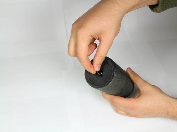 Locate D-ring on the bottom of the speaker.