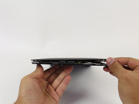Remove back panel by pulling away from the remaining device.