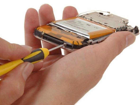 Removing ten Phillips #00 screws around the perimeter of the iPhone.