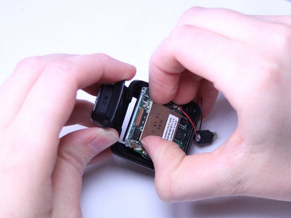 Use your fingers to gently pull the whole green motherboard out of the Front Casing.