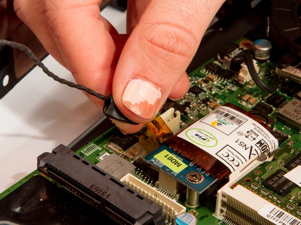 Remove the black signal cable attached at the blue circuit board.