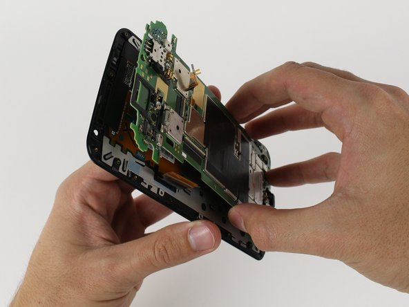 Peel the motherboard off of the screen with your hands.