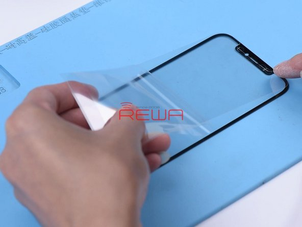 Attach the OCA adhesive to the glass lens.