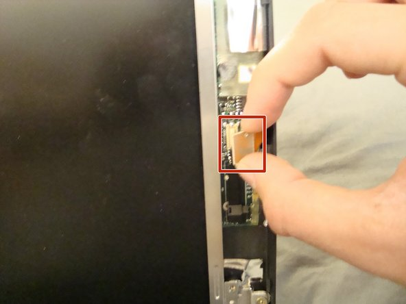 Using your fingers or an Opening Tool, detach the connector on the right side of the screen.