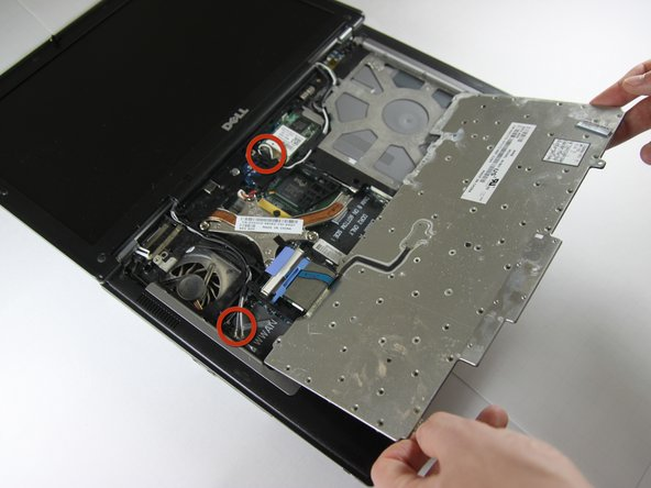 Detach cables that connect the display to the body of the laptop