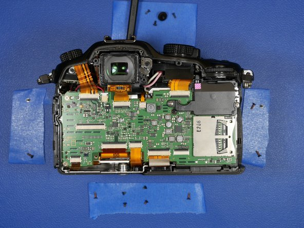 Back to the rest of the camera. With the back LCD shell assembly removed from the body of the camera, It's time to remove the main PCB.