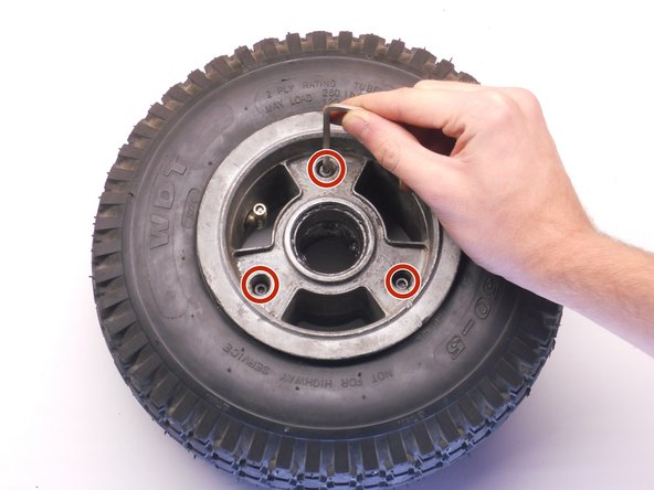 Insert all the bolts into the top rim half.