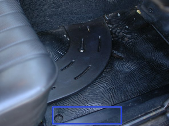 Once inside the car, the lock and unlock vacuum lines travel beneath the carpets and  in some places underneath flexible black plastic covers. Begin by removing the floor mat, if equipped, and carpet in the driver's foot well.