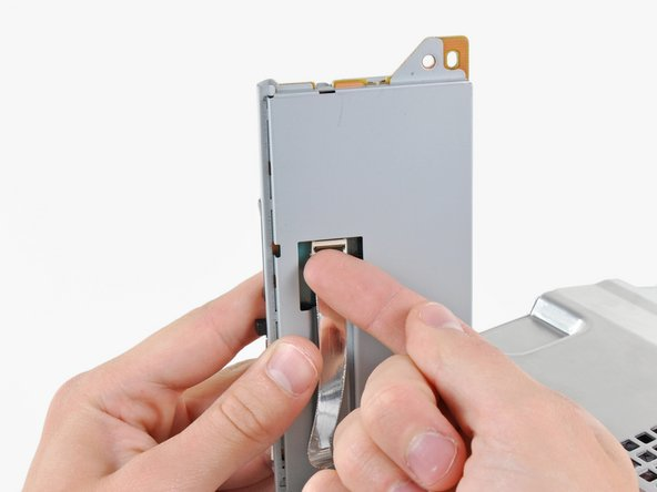 Lift the memory card reader out of the PS3 enough to access its ribbon cable.