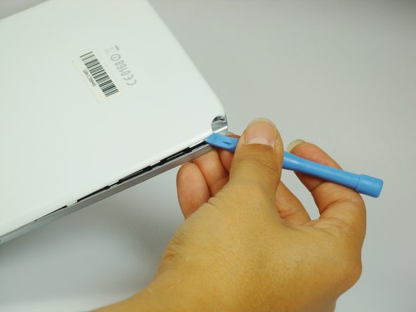 Using the plastic opening tool, start where the S-pen was located and carefully pry up the corner.