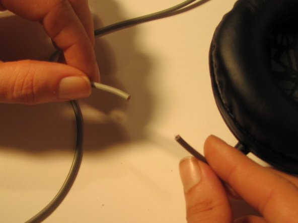Using wire cutters, cut the auxiliary cable at the determined damaged area.