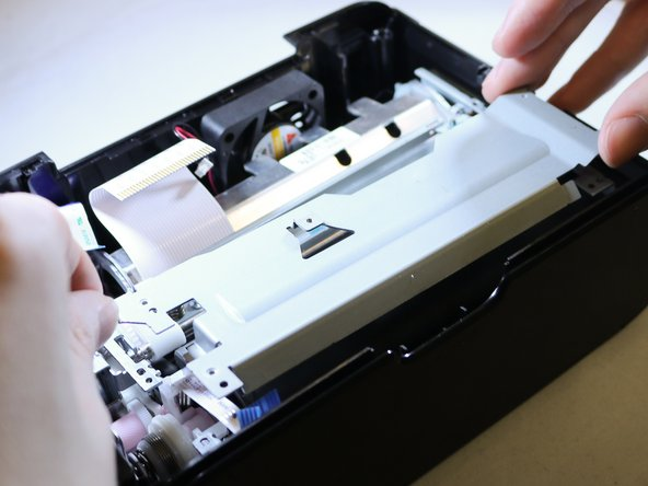 Lift out the print mechanism of the printer case.