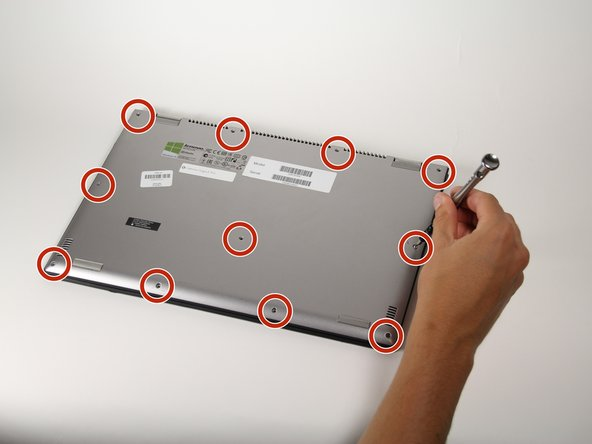 """Using a Torx T5 screwdriver, remove the eleven 1/4"""" screws from the back of the laptop."""