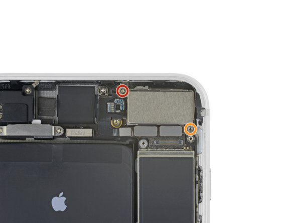 Remove the two screws securing the rear camera module cover plate: