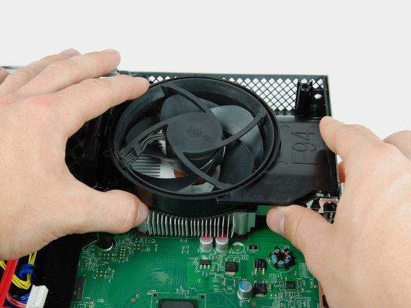 Lift the fan duct off the fan.
