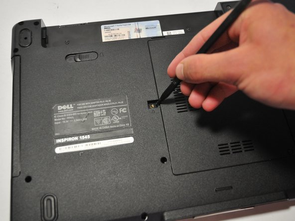 Push the Optical Disk Drive out using a spudger tool as shown and pull from the front cover of the Optical Disk Drive.