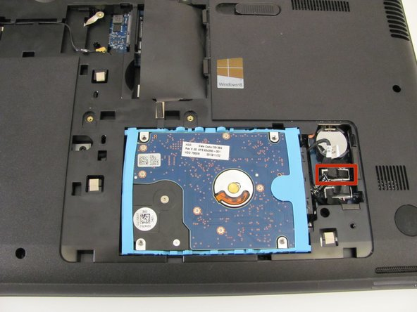 Using a spudger, disconnect the hard drive connecting cable. Use a slow, prying motion as if pulling a nail out of wood.