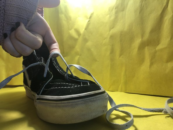 Continue removing the lace from each side's eyelets until the shoe reaches the last eyelet set.