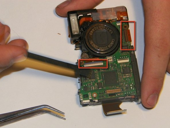There are two ribbon cables that must be unplugged before removing the assembly. To remove them, simply unsnap the jawbone connectors and then gently pull them out with either the tweezers or the spudger.