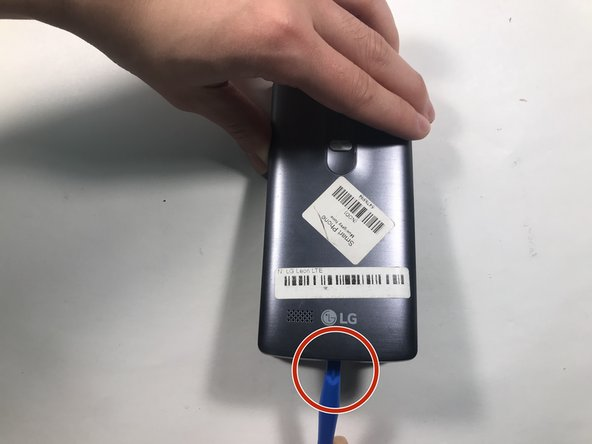 Second,  using your opening tool in an upward direction, carefully pry the back of the phone open at the incision area. This can be found at the bottom of the phone. You will now have access to the battery.