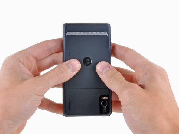 Slide the battery cover toward the bottom edge of the phone.