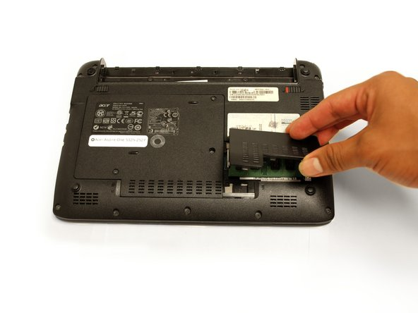 Once the plate becomes unhinged, gently rotate the plate to take it of of the device.