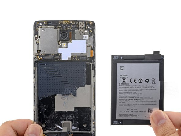 Remove the battery and any remaining adhesive residue on the frame.