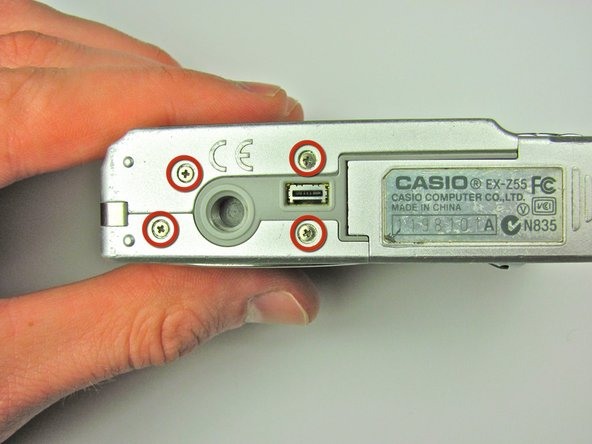 Remove the four 3.7 mm screws from the bottom of the camera using a Phillips #00 screwdriver.