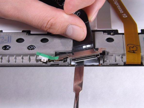 Lift the charger port with the flat end of the heavy-duty spudger and remove it from the device.