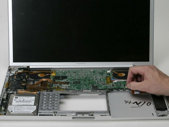 In order to deroute the speaker cable from the front edge of the logic board, you must disconnect the PRAM battery cable.